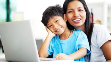 happy parent and child at a computer