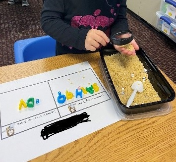 Student sorting letters