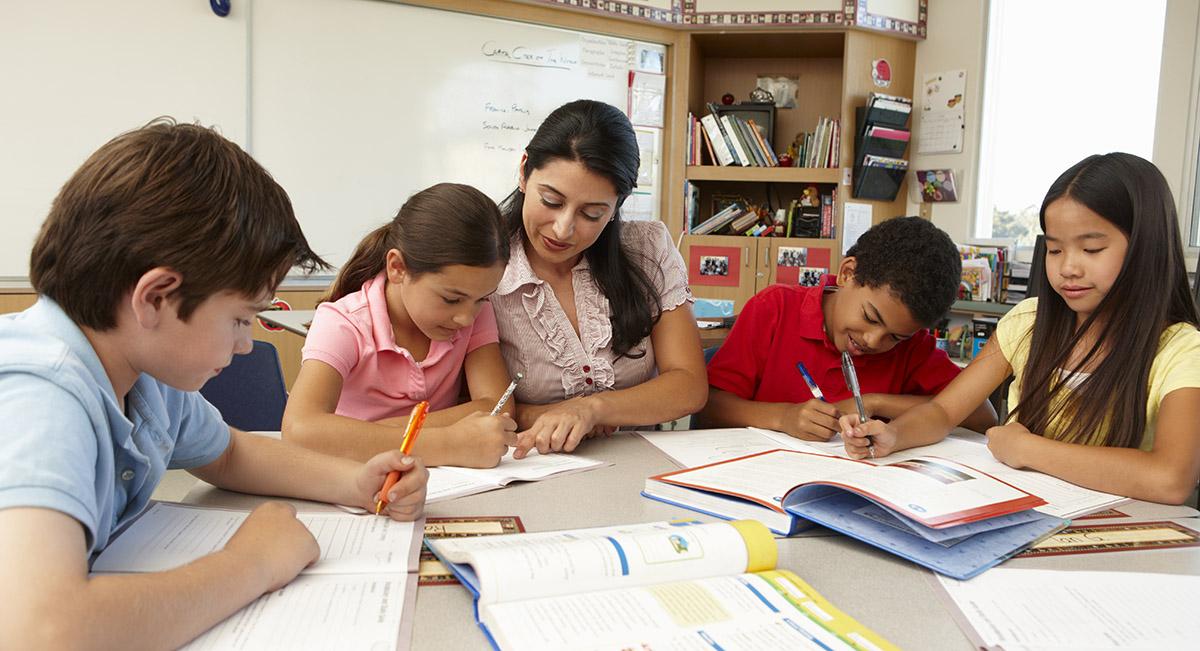 Teacher working with group of students in classroom