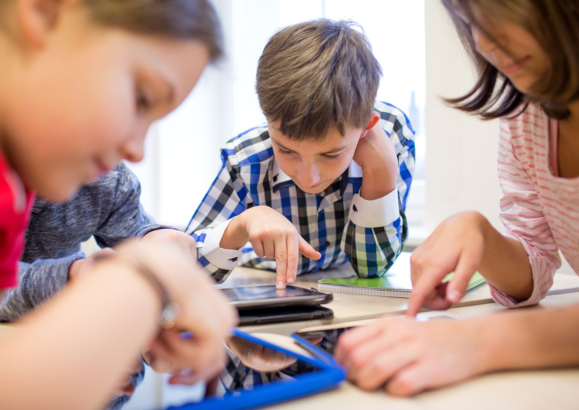 Students using devices.