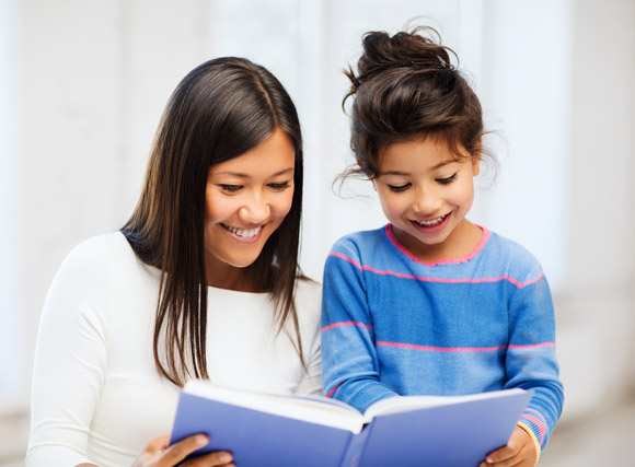 Parent and child reading book