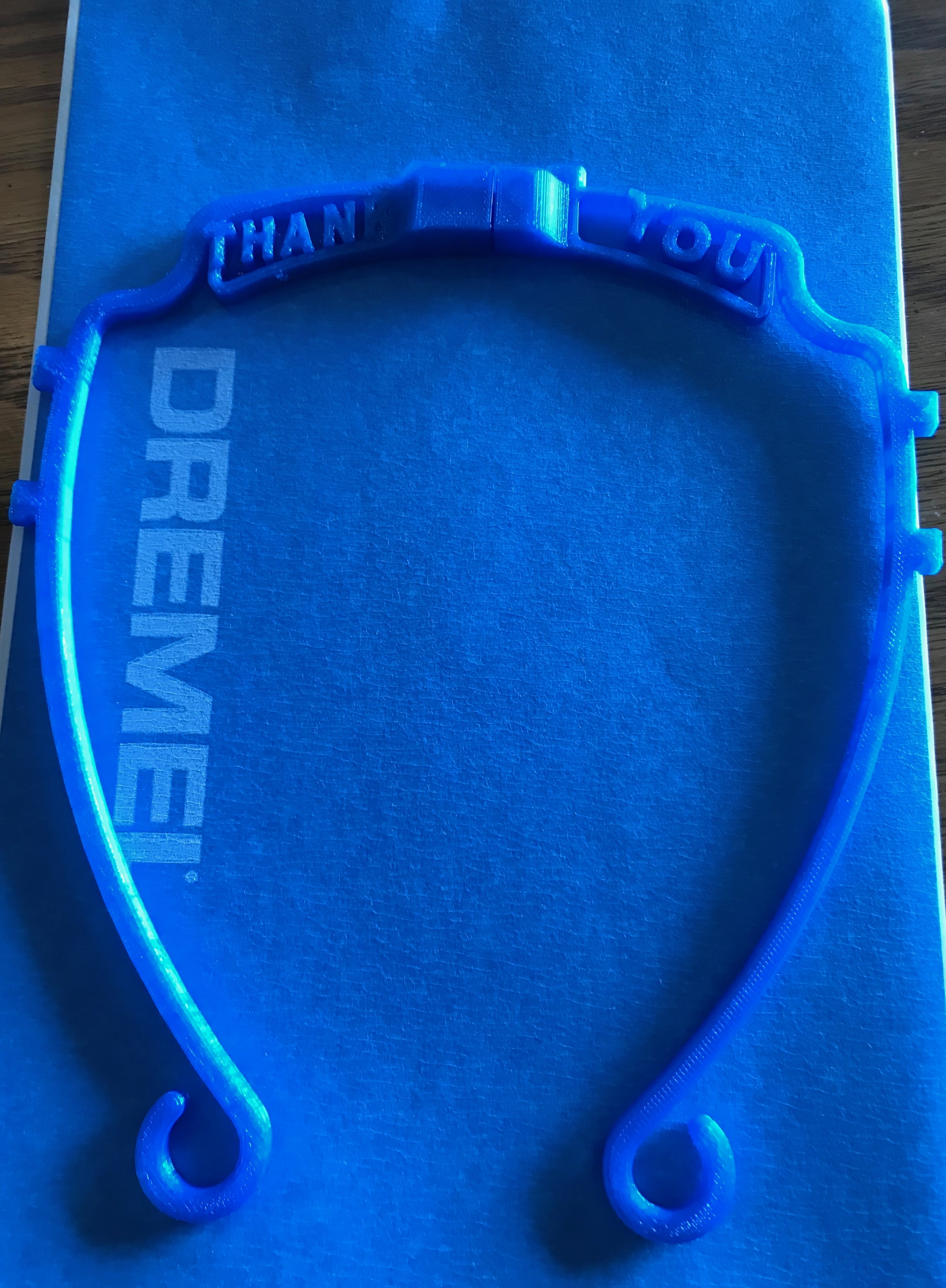 A 3D printed face mask frame with a personalized message
