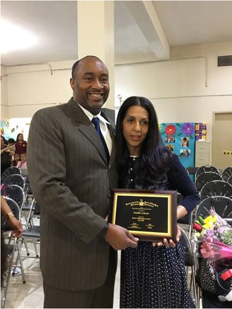 2019 Better Beginnings award recipient Eunilda Achecar with Assistant Commissioner Dr. Anael Alston