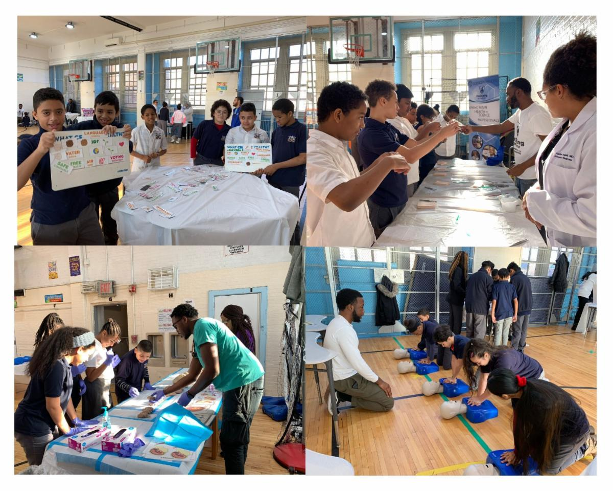 Middle school students participating in hands-on lessons from physicians and pre-health college students