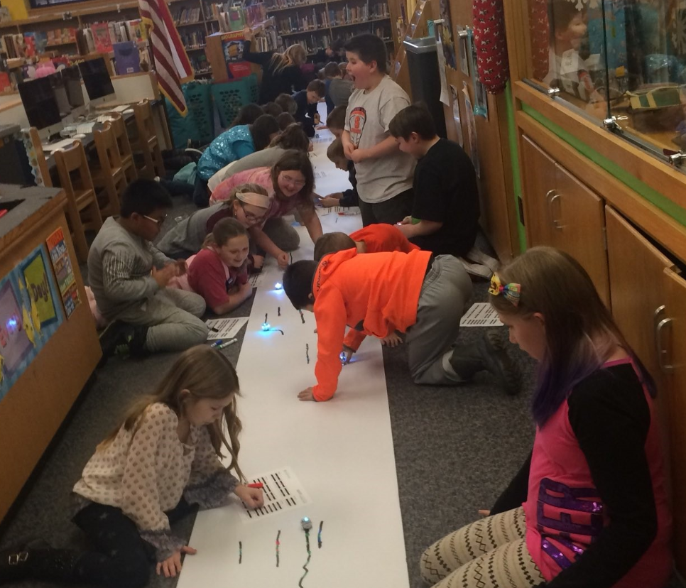 Makerspace Club coding and collaborating with Ozobots