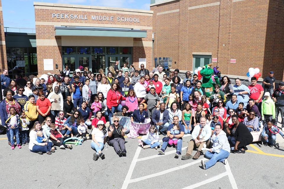 Large group of community members gathered outside Peekskill Middle School.
