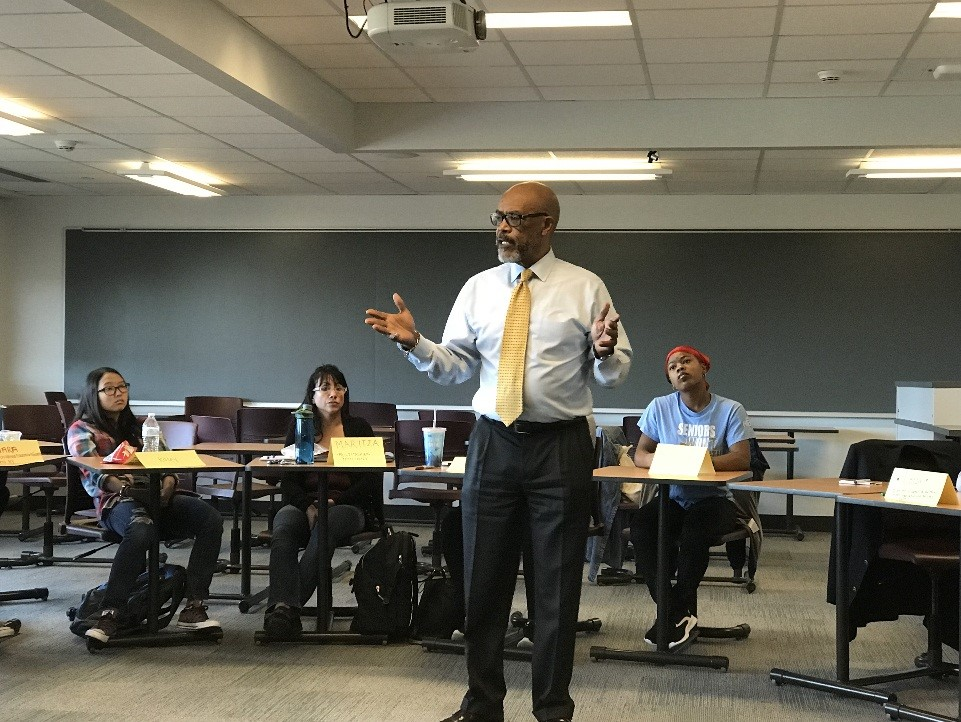 Regent Young speaking with TOC II students at SUNY Oswego