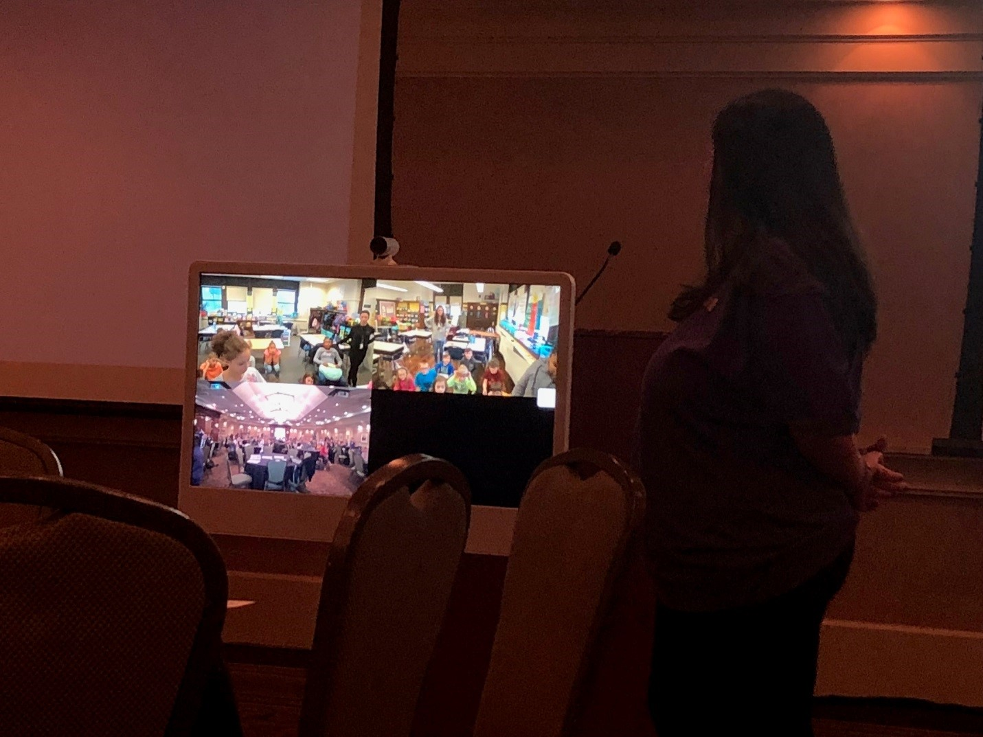 Sheevers connecting with two classrooms at TCSD through video conferencing at the NERIC conference
