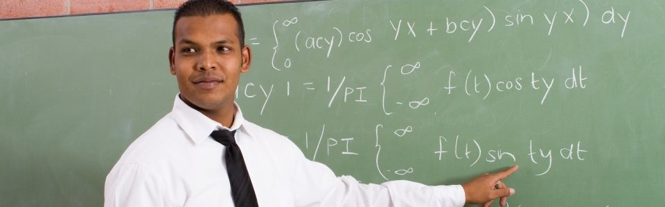 picture of teacher teaching math at chalkboard