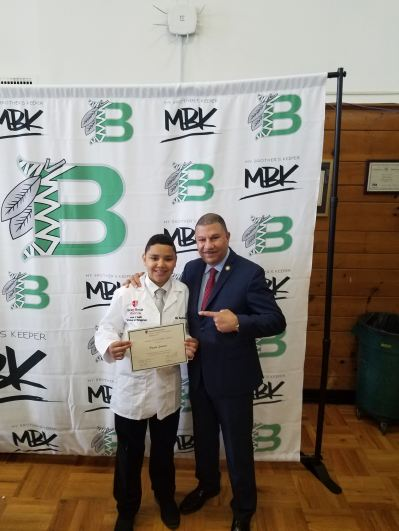 Assemblyman Phil Ramos with a Brentwood MBK student