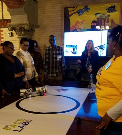 Parents and staff participating in Battle Bots demonstration