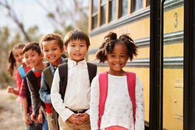 Elementary school students at school bus