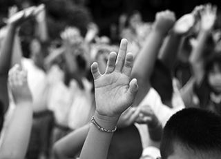 Students raising hands