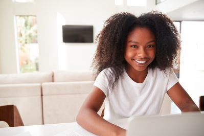 Smiling teenage girl with a computer