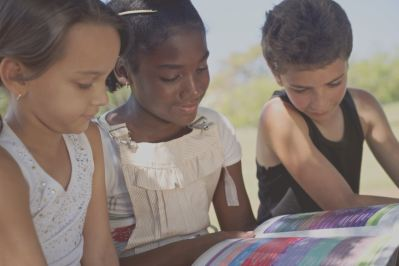 three children reading