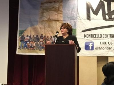 Commissioner MaryEllen Elia speaking at the MBK Fellows and Friends Retreat