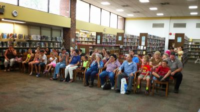 Audience at an event in a library.