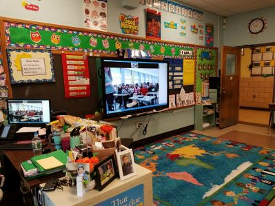 Students videoconferencing with another classroom in school