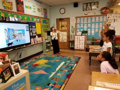 Students watching a television in the classroom
