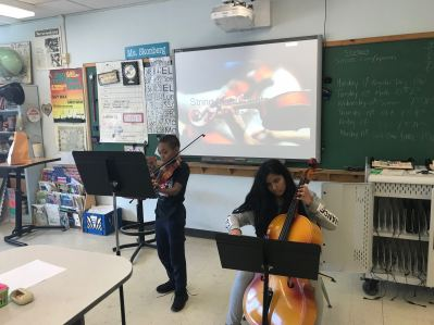 Student presenting for Genius Hour about string instruments.