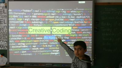 Student presenting for Genius Hour about coding.