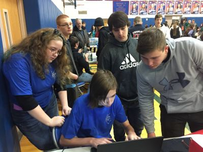 Students using a computer.