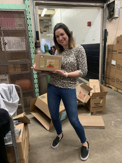 Kelly Spurduto holds a box ready for delivery