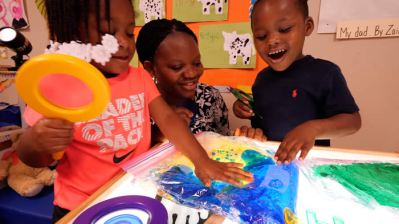 Pre-K Teacher and Children Creating Art