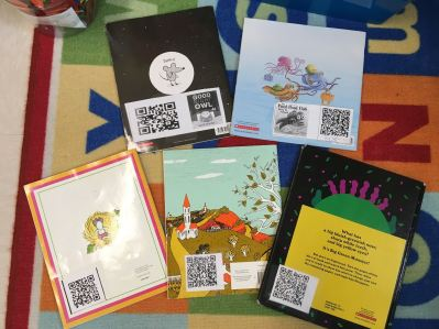 QR Codes taped to back of classroom library books