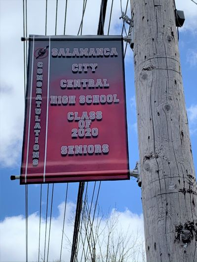 Banner celebrating Class of 2020 students hands from a utility pole