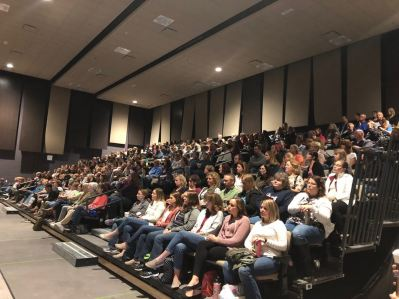 450 educators from Schoharie County schools sit in an amphitheater during a professional development day