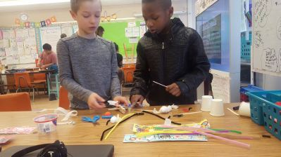 Students creating a project in a Makerspace session