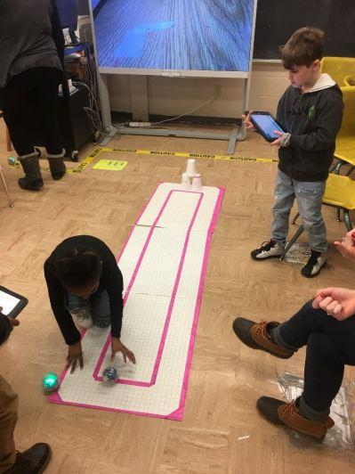 Students engaging in a STEAM day activity