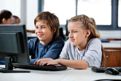 Two students sitting in front of a computer