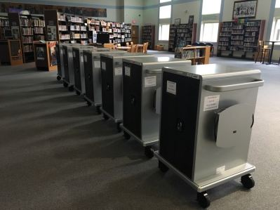 Carts with classroom sets of Chromebooks.