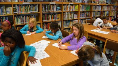 Livorno Unit School students learning about Martin Luther King Jr. celebration during a lesson held at the school library.