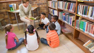 Librarian with students in library