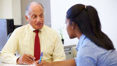 student talking to school counselor