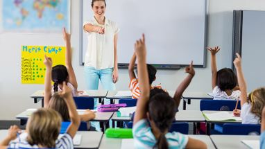 Teacher and students raising hands