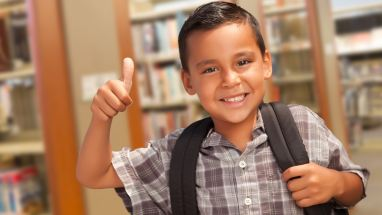 student in library with backpack